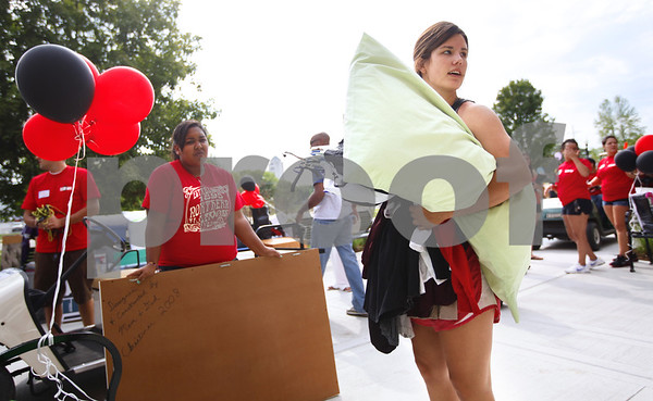 Kyle Bursaw – kbursaw@shawmedia.com<br /> <br /> Outside the front of New Residence Hall East, NIU juniors Hailey Shelton (left) and Lucy Albers look around for an extra pair of hands to bring the last of Albers things to her room on Thursday, Aug. 23, 2012.