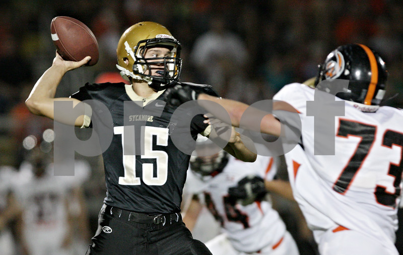 Rob Winner – rwinner@shawmedia.com<br /> <br /> Sycamore quarterback Devin Mottet looks to pass during the first quarter in Sycamore Friday, Aug. 24, 2012.