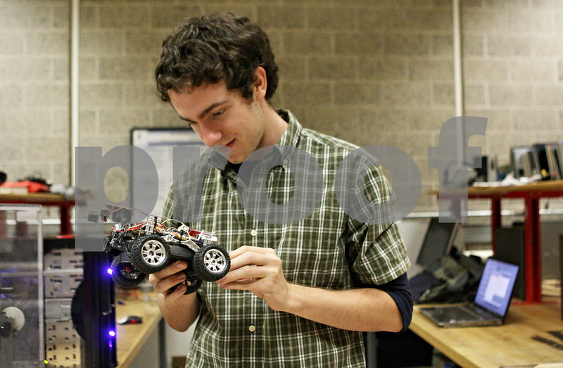 Rob Winner – rwinner@shawmedia.com<br /> <br /> Northern Illinois University junior Ryan Riddel prepares his autonomous sonic car before a test run within a lab at the Engineering Building Friday afternoon. Riddel, with the help of local businesses, plans to launch a competitive robotics club at NIU.