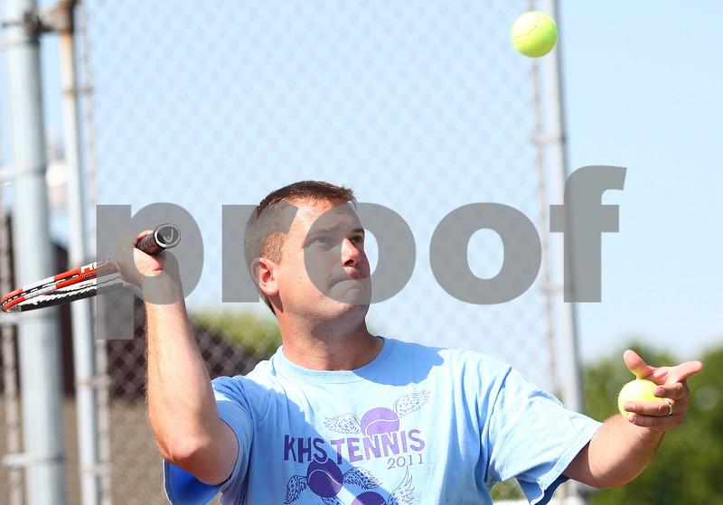 Kyle Bursaw – kbursaw@shawmedia.com<br /> <br /> Kaneland girls tennis coach Tim Larsen hits balls to his players in a drill at practice on Wednesday, Aug. 15, 2012.
