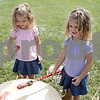 Rob Winner – rwinner@shawmedia.com<br /> <br /> Twins Claire (left) and Kendall Hutchison, 3, of Sycamore, beat on a pow-wow drum during the Boy Scout Troop 33 Living History event at Kiwanis Park in DeKalb Saturday, Aug. 18, 2012.