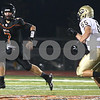 Kyle Bursaw – kbursaw@shawmedia.com<br /> <br /> DeKalb quarterback Jack Sauter rolls out as Galesburg's Matt Hawkins pursues in the second quarter of the game Friday, Aug. 24, 2012.
