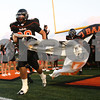 Kyle Bursaw – kbursaw@shawmedia.com<br /> <br /> DeKalb's Jake Smith leads the Barbs out of the tunnel in their home opener against Galesburg on Friday, Aug. 24, 2012.