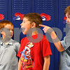 Kyle Bursaw – kbursaw@shawmedia.com<br /> <br /> North Grove first-graders Ben Larry (center) and Elija Herra (right) enviously glance to the playground where they can see another grade enjoying recess while waiting in line to practice the procedure for selecting their lunches with Tritan Melton (left) and the rest of Kelly Wright's class on Wednesday, Aug. 22, 2012.