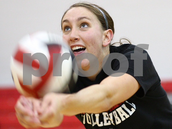 Kyle Bursaw – kbursaw@shawmedia.com<br /> <br /> Northern Illinois University senior Mary Kurisch digs the ball while running a drill at practice on Monday, Aug. 20, 2012.