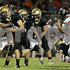 Rob Winner – rwinner@shawmedia.com<br /> <br /> Sycamore quarterback Devin Mottet carries the ball during the second quarter in Sycamore Friday, Aug. 24, 2012.