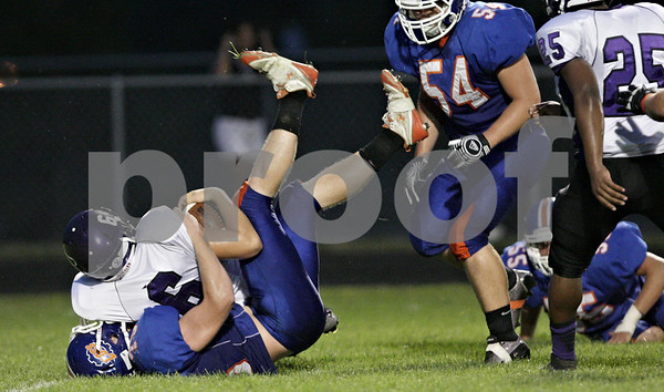Rob Winner – rwinner@shawmedia.com<br /> <br /> Rockford Lutheran quarterback Jake Milbourn (6) is sacked by Genoa-Kingston offensive lineman Connor Bankson (bottom) during the first quarter in Genoa Friday, Aug. 31, 2012.