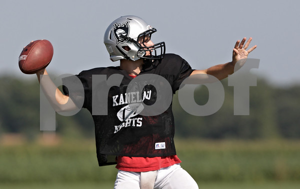 Rob Winner – rwinner@shawmedia.com<br /> <br /> Kaneland quarterback Drew David looks to pass during practice in Maple Park Thursday, Aug. 30, 2012.
