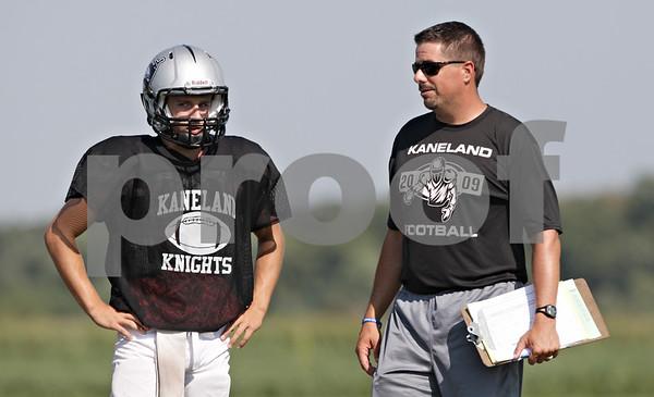 Rob Winner – rwinner@shawmedia.com<br /> <br /> Kaneland quarterback Drew David speaks with coach Tom Fedderly during practice in Maple Park Thursday, Aug. 30, 2012.