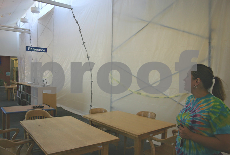 Jeff Engelhardt – jengelhardt@shawmedia.com<br /> Katherine Keyes, assistant director of Sycamore Public Library, looks at the construction taking place on the second floor. The second floor will be closed from Sept. 10 to Oct. 1.