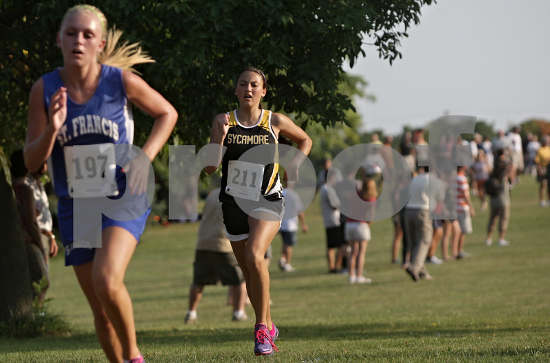 Rob Winner – rwinner@shawmedia.com<br /> <br /> Sycamore's Morgan Morreale (right) approaches the finish line during the Sycamore Invitational at Afton Forest Preserve Tuesday.