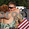 Rob Winner – rwinner@shawmedia.com<br /> <br /> After a parade through downtown, Genoa Marine Cpl. Christopher Wilkins is hugged by his mother, Robin Grabowski of Belvidere, outside the Genoa Veterans Home on Saturday. Wilkins, a 2009 Genoa-Kingston High School graduate, had served in Afghanistan. Wilkins and his wife, Alexandra, are expecting their first child in September and friends and family held a baby shower after the parade.