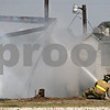 Rob Winner – rwinner@shawmedia.com<br /> <br /> A Maple Park firefighter uses a hose to stop the spread of flames while responding to a barn fire located on West Lincoln Highway in DeKalb, Ill., Saturday, Aug. 25, 2012.