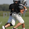 Rob Winner – rwinner@shawmedia.com<br /> <br /> Kaneland running back Dan Goress (front) takes a handoff from quarterback Drew David during practice in Maple Park Thursday, Aug. 30, 2012.