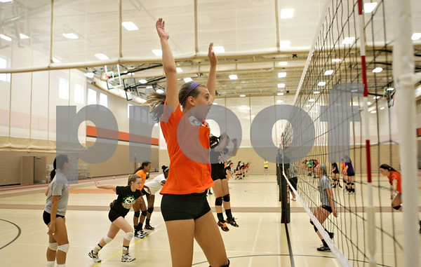 Rob Winner – rwinner@shawmedia.com<br /> <br /> DeKalb junior Courtney Wagner leaps up toward the net during a drill at practice Wednesday, Aug. 29, 2012.