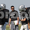 Rob Winner – rwinner@shawmedia.com<br /> <br /> Kaneland coach Tom Fedderly looks over his players during practice in Maple Park Thursday, Aug. 30, 2012.