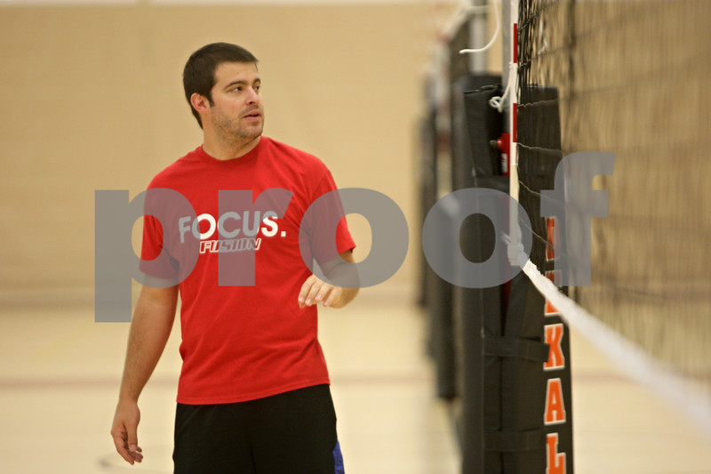 Rob Winner – rwinner@shawmedia.com<br /> <br /> DeKalb coach Ben Fisher instructs his players during volleyball practice Wednesday, Aug. 29, 2012.