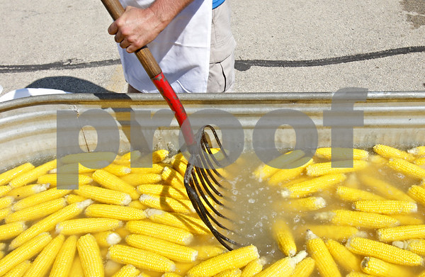 Rob Winner – rwinner@shawmedia.com<br /> <br /> Mike Craft uses a silage fork to stir up steamed sweet corn for guests to Corn Fest Saturday afternoon at the DeKalb Taylor Municipal Airport. <br /> <br /> Saturday, Aug. 25, 2012<br /> DeKalb, Ill.