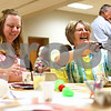"Kyle Bursaw – kbursaw@shawmedia.com<br /> <br /> Sara Smith (left), a girl scout leader in Belvidere, and Penny Lauritzen, of Illinois Agri-Women, work on creating an emergency landing device for 'astronauts' made of marshmallows, an activity in the ""Boosting Girls' Interest in Engineering"" seminar in the Holmes Student Center on Monday, Aug. 27, 2012."