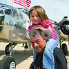 "Curtis Clegg - cclegg@shawmedia.com<br /> Stella Meyer, 3, of Hampshire with her grandfather Dean Meyer in front of the B-25 Bomber ""Miss Mitchell"" at DeKalb Taylor Municipal Airport on Friday, August 24, 2012. The B-25 will be part of the air fest at the airport during Corn Fest through Sunday afternoon."