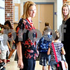 Kyle Bursaw – kbursaw@shawmedia.com<br /> <br /> North Grove Elementary teacher Kim Payne (right) and NIU student and 'teacher candidate' Kara Christensen lead their first grade class gets to gym  on Wednesday, Aug. 29, 2012. North Grove and NIU have partnered to increase the length and responsibilities of their student teaching program, placing aspiring teachers, like Christensen, in a classroom for a full academic year.