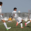 Rob Winner – rwinner@shawmedia.com<br /> <br /> Genoa-Kingston's Cristian Camargo (center) takes a shot at the Winnebago goal during the first half in Genoa Wednesday, Aug. 29, 2012. G-K defeated Winnebago, 2-1.