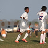 Rob Winner – rwinner@shawmedia.com<br /> <br /> Genoa-Kingston's Cristian Camargo (center) is congratulated by Eric Tomlinson after Camargo's goal during the second half in Genoa Wednesday, Aug. 29, 2012. G-K defeated Winnebago, 2-1.