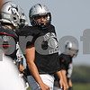 Rob Winner – rwinner@shawmedia.com<br /> <br /> Kaneland center Nick Sharp looks down the line before a play during practice in Maple Park Thursday, Aug. 30, 2012.