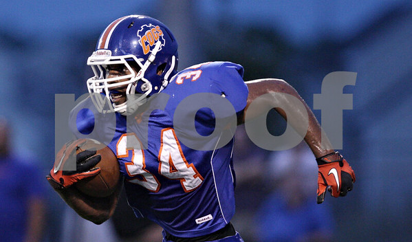 Rob Winner – rwinner@shawmedia.com<br /> <br /> Genoa-Kingston's Gabe Williams runs back a kickoff to midfield during the first quarter in Genoa Friday, Aug. 31, 2012.