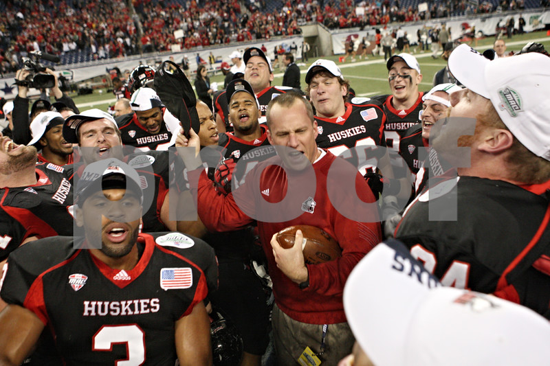 Rob Winner – rwinner@shawmedia.com<br /> <br /> Coach Dave Doeren celebrates with his team after Northern Illinois defeated Ohio, 23-20, for the Mid-American Conference championship in Detroit, Mich., on Friday, Dec. 2, 2011.