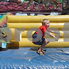 Rob Winner – rwinner@shawmedia.com<br /> <br /> Lawrence Hapeman, 9, of Muskego, Wis., hops down from a slide during Corn Fest at the DeKalb Taylor Municipal Airport Saturday afternoon. <br /> <br /> Saturday, Aug. 25, 2012<br /> DeKalb, Ill.