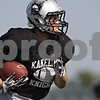 Rob Winner – rwinner@shawmedia.com<br /> <br /> Kaneland's Jesse Balluff carries the ball after a reception during practice in Maple Park Thursday, Aug. 30, 2012.