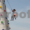 Rob Winner – rwinner@shawmedia.com<br /> <br /> After climbing to the top of an inflatable wall at Corn Fest on Saturday, Nyssa Doss, 11, of Chicago, is seen rappelling back to the ground.<br /> <br /> Saturday, Aug. 25, 2012<br /> DeKalb, Ill.