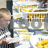 Rob Winner – rwinner@shawmedia.com<br /> <br /> Sycamore resident Liam Wakeland, 6, helps himself to free steamed sweet corn Saturday afternoon during Corn Fest at the DeKalb Taylor Municipal Airport. <br /> <br /> Saturday, Aug. 25, 2012<br /> DeKalb, Ill.