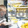 Rob Winner – rwinner@shawmedia.com<br /> <br /> Sycamore resident Liam Wakeland, 6, helps himself to free steamed sweet corn Saturday afternoon during Corn Fest at the DeKalb Taylor Municipal Airport. <br /> <br /> Saturday, Aug. 25, 2012<br /> DeKalb, Ill.