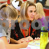 Kyle Bursaw – kbursaw@shawmedia.com<br /> <br /> Kara Christensen, an NIU student, works with a table of first-graders including Alaina Bowman (left) on Wednesday, Aug. 29, 2012. North Grove and NIU have partnered to increase the length and responsibilities of their student teaching program, placing aspiring teachers, like Christensen, in a classroom for a full academic year.