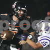 Kyle Bursaw – kbursaw@shawmedia.com<br /> <br /> DeKalb quarterback Jack Sauter escapes the grasp of Hampshire's Nicholas Kielbasa during the second quarter of the game at DeKalb High School on Friday, Aug. 31, 2012.