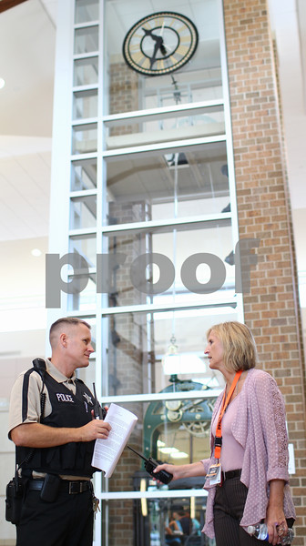 Kyle Bursaw – kbursaw@shawmedia.com<br /> <br /> New DeKalb principal Tamra Ropeter (right) and Detective Aaron Lockhart, the school resource officer, discuss a matter near the school's front entrance on Wednesday, Aug. 29, 2012.