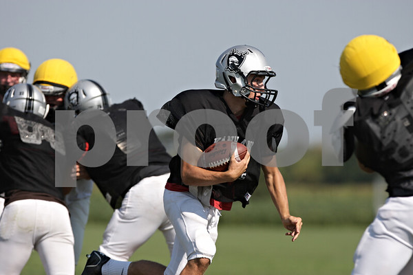 Rob Winner – rwinner@shawmedia.com<br /> <br /> Kaneland quarterback Drew David carries the ball during practice in Maple Park Thursday, Aug. 30, 2012.