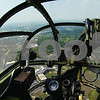 "Curtis Clegg - cclegg@shawmedia.com<br /> The DeKalb County landscape passes below the plexiglass nose cone of the World War II-era B-25 bomber ""Miss Mitchell"" on Friday, August 24, 2012. The B-25 will be part of the air fest at the DeKalb Taylor Municipal Airport during Corn Fest through Sunday afternoon."