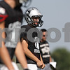 Rob Winner – rwinner@shawmedia.com<br /> <br /> Kaneland quarterback Drew David looks over his offensive line during practice in Maple Park Thursday, Aug. 30, 2012.