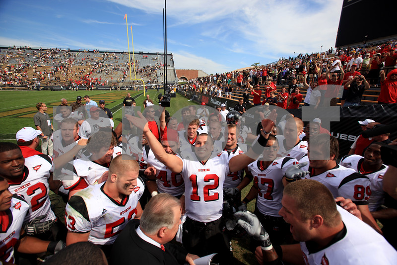 Beck Diefenbach – bdiefenbach@daily-chronicle.com<br /> <br /> Northern Illinois quarterback Chandler Harnish (12) leads the Huskies in celebrating the defeat of Purdue University in West Lafayette, Ind., on Saturday Sept. 19, 2009