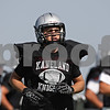 Rob Winner – rwinner@shawmedia.com<br /> <br /> Kaneland wide receiver Zach Martinelli gets into position during practice in Maple Park Thursday, Aug. 30, 2012.