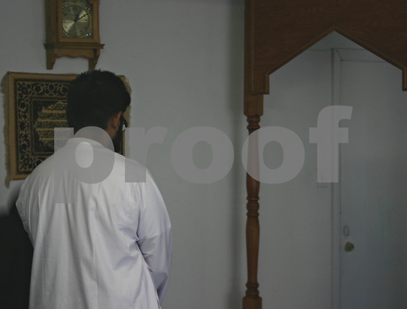 Jeff Engelhardt – jengelhardt@shawmedia.com<br /> Adnan Kahn, an NIU student and member of the Islamic Society of Northern Illinois University, prays at the mosque Wednesday. The Islamic Society recently finished observing Ramadan and hopes next year's will be in a new mosque.