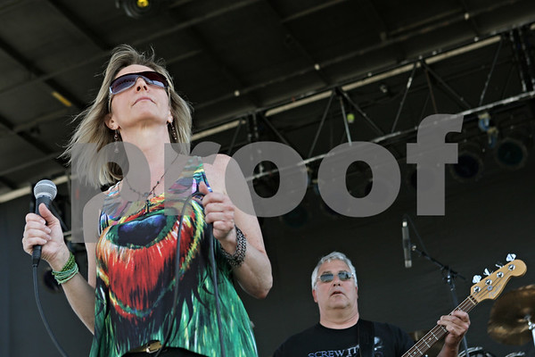 Rob Winner – rwinner@shawmedia.com<br /> <br /> Members of the band Field Day, including Cindy Arias (left) and Bill Conrades, entertain the Corn Fest crowd Saturday afternoon at the DeKalb Taylor Municipal Airport.