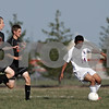 Rob Winner – rwinner@shawmedia.com<br /> <br /> Genoa-Kingston's Cristian Camargo (right) controls a ball near the Winnebago goal during the first half in Genoa Wednesday, Aug. 29, 2012. G-K defeated Winnebago, 2-1.