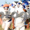 Kyle Bursaw – kbursaw@shawmedia.com<br /> <br /> Genoa-Kingston's Nathan Mousser leads his teammates in a drill on Tuesday, Aug. 28, 2012.
