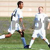 Kyle Bursaw – kbursaw@shawmedia.com<br /> <br /> Sycamore players Kendryck Rand (12) and Adam Millburg (1) celebrate a Sycamore goal in the first half against Sandwich at Sycamore High School on Monday, Aug. 27, 2012.