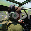 "Curtis Clegg - cclegg@shawmedia.com<br /> Terrel Stern, co-pilot of the World War II-era B-25  bomber ""Miss Mitchell"" in the cockpit of the plane as it banks left to make its final approach to DeKalb Taylor Municipal Airport on Friday, August 24, 2012. The B-25 will be part of the air fest at the airport during Corn Fest through Sunday afternoon."