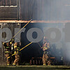 Rob Winner – rwinner@shawmedia.com<br /> <br /> Firefighters inspect a corn crib located on Lloyd Collier's property on West Lincoln Highway in DeKalb, Ill., Saturday, Aug. 25, 2012.